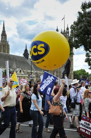 protestors: LONDON - JUNE 30; Protestors consisting of teachers and other civil servants march against pension reforms and spending cuts proposed by the government. The demonstration was organised by trade unions in London on June 30, 2011