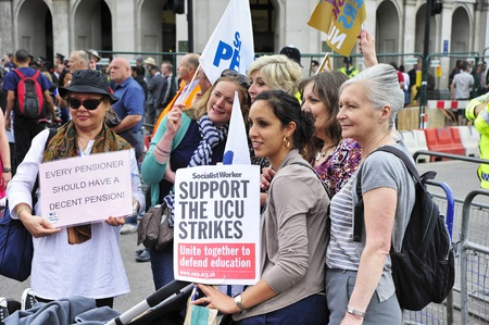 oap: LONDON - JUNE 30; Unidentified teachers protest against proposed pension reforms made by the government during a march organised by PCS and NUT teachers unions in London on June 30, 2011 Editorial