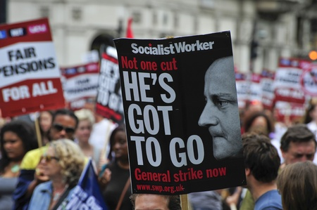 strong message: LONDON - JUNE 30; Strong message placards are displayed by unidentified members of trade unions during a demonstration against proposed spending cuts was organised by trade unions in London on June 30, 2011