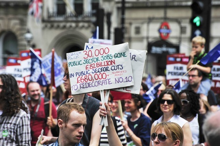 organised: LONDON - JUNE 30; Unidentified members of trade unions make their feelings clear during a march against proposed spending cuts. The demonstration was organised by various trade unions in London on June 30, 2011