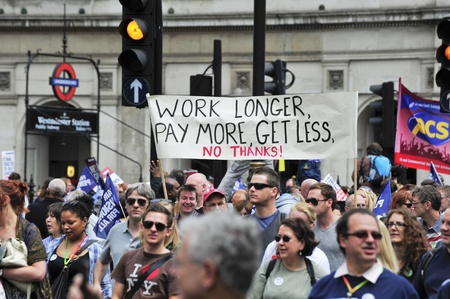 organised: LONDON - JUNE 30; Unidentified members of trade unions march through London in protest against spending cuts and pension reform. The demonstration was organised by various trade unions in London on June 30, 2011