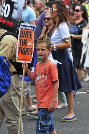 LONDON - JUNE 30; An unidentified child joins the protest against proposed government cuts and pension reform during a demonstration  organised by NUT and PCS trade unions in London on June 30, 2011 Stock Photo - 9890539