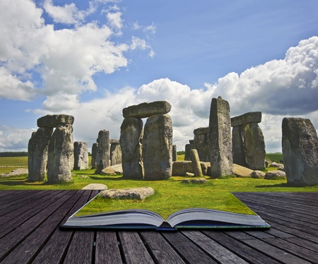 Creative concept image of Stonehenge, a 5000 year old monument coming out of the pages in a mgaical book photo