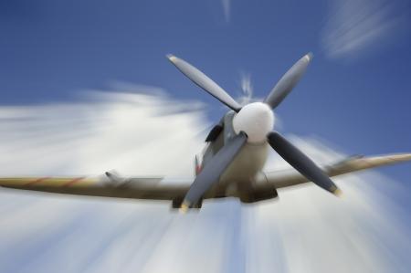 world war two: World War Two era British Spitfire aircraft in flight