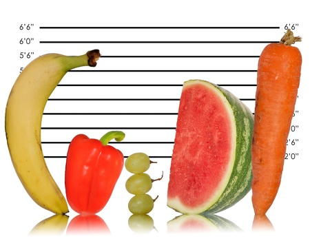 unusual vegetables: Unique creative image of fruit lined up against police ID line up
