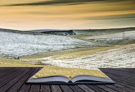 Creative concept idea of Winter landscape coming out of pages in magical book Stock Photo - 10313424