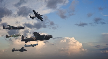 allies: Flight formation of Battle of Britain World War Two consisting of Lancaster bomber, Spitfire and hurricane airplanes Stock Photo