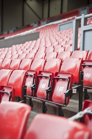 stadia: Rows of colored seats in sports football stadium Stock Photo