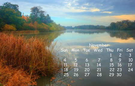 Calendar page for November 2012 of English landscape scene of foggy lake during Autumn Winter sunrise photo