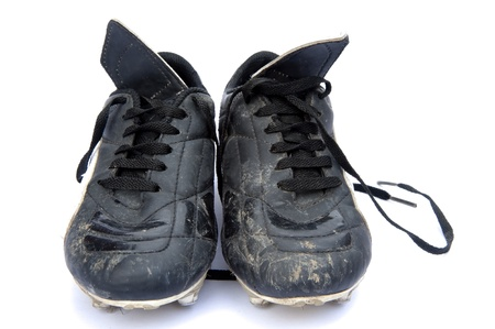 dirty football: Black leather football soccer boots isolated on white background Stock Photo