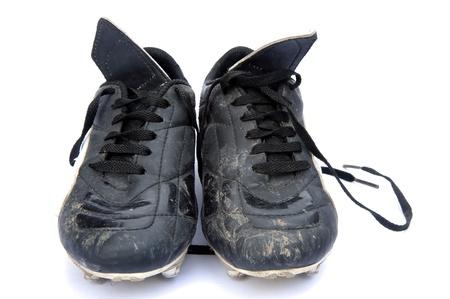 iszapos: Fekete bőr foci futball cipő elszigetelt fehér háttér