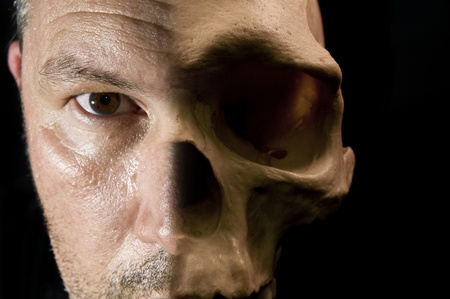 baclground: Face with half skin and half skull bone visible scary Halloween concept Stock Photo