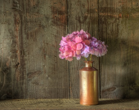 Still life image of dried flowers in rustic vase against weathered wooden background Stok Fotoğraf