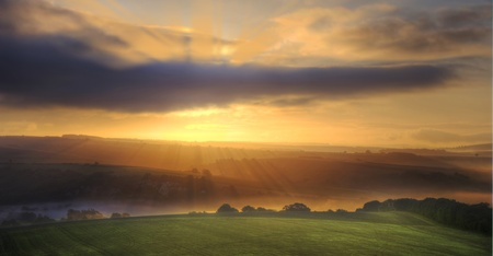 Beautiful golden sunrise glow over fields Stock Photo - 10752668