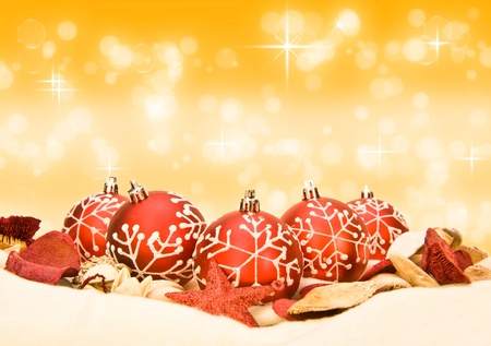Sparkling red Christmas baubles on blurred bokeh golden background photo