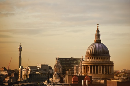 Lovely colorful image of St Pauls cathedral in London during Winter sunset over city skyline photo