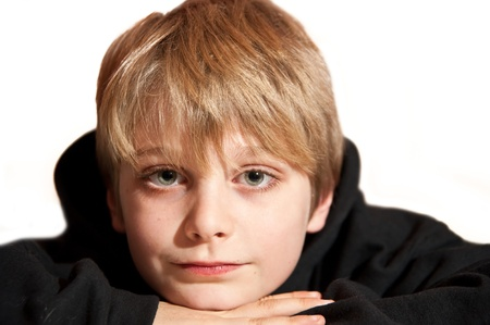 mischevious: Close up portrait of young handsome boy with expressive face Stock Photo