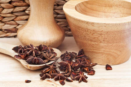 aniseed: Star anise in rustic kitchen scene with wooden utensils