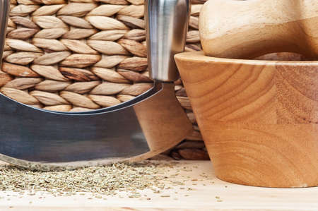 rustic kitchen: Chopped rosemary with herb chopper in rustic kitchen setting Stock Photo