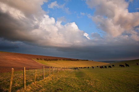 Beautiful countryside landscape across rolling hills with lovely cloud formations photo