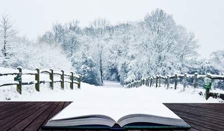 Snow Winter landscape countryside scene with English countryside coming out of pages in magic book