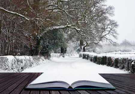 Snow Winter landscape countryside scene with English countryside coming out of pages in magical book
