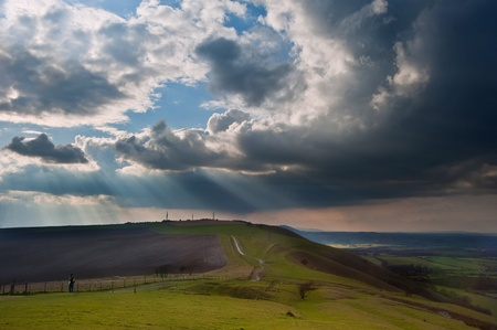 Beautiful countryside landscape across rolling hills with lovely cloud formations Stock Photo - 13101966