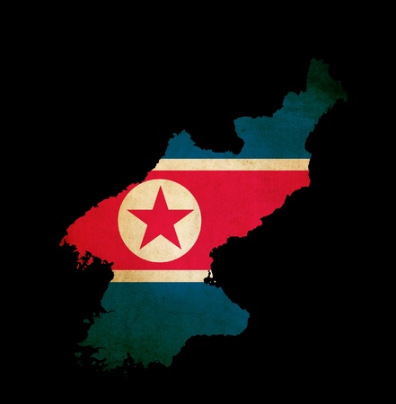 Map outline of North Korea with grunge map insert isolated on black Stock Photo - 13101932