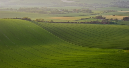 Light hits hills on rolling landscape in English countryside photo