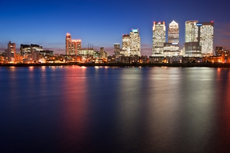 View of London City skyline at night on clear sky with reflections in River Thames Editorial