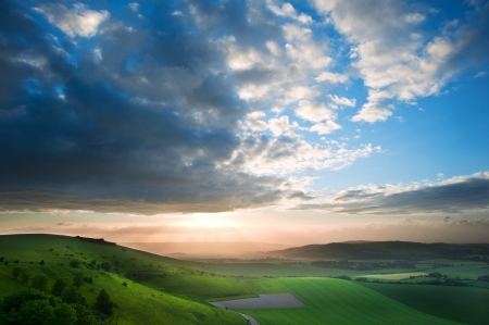 Stunning landscape at sunset over rolling English countryside
