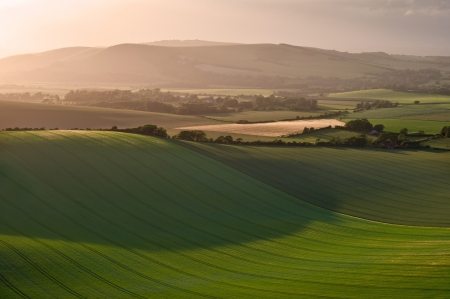 Stunning landscape at sunset over rolling English countryside photo