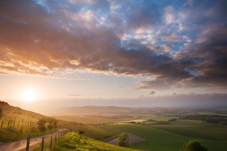 sunlgiht: Stunning landscape at sunset over rolling English countryside