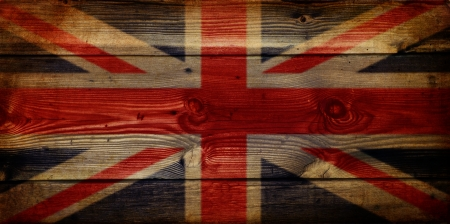 Grunge effect on wooden texture of GB Union Jack flag photo