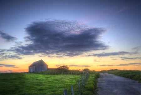 Sunset landscape image of old barn in countryside fields photo