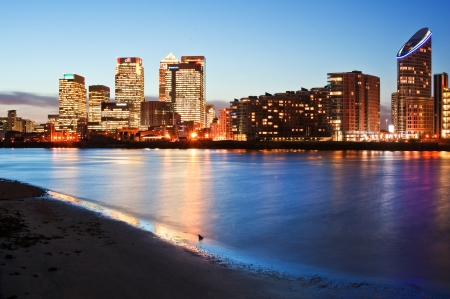 lighhts: View of London City skyline at night on clear sky with reflections in River Thames Editorial
