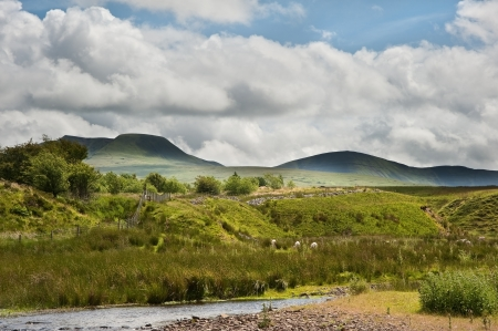 natural moody: Beautiful landscape across countryside to mountains in distance with moody sky