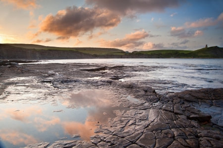 Beautiful sunrise landscape image at Kimmeridge Bay on Jurassic Coast, Dorset, England photo