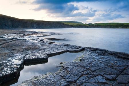 kimmeridge: Beautiful sunrise landscape image at Kimmeridge Bay on Jurassic Coast, Dorset, England