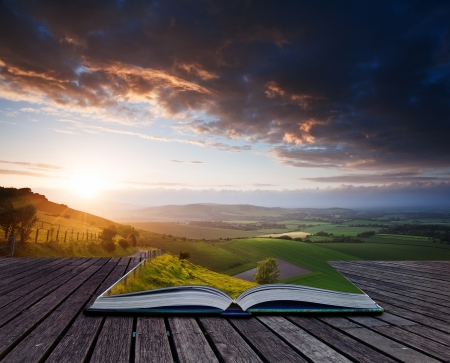 vulnerable: Creative composite image of Summer landscape in pages of magic book