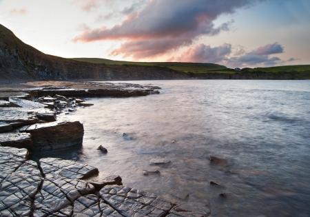 Beautiful sunrise landscape image at Kimmeridge Bay on Jurassic Coast, Dorset, England Stock Photo - 14929224