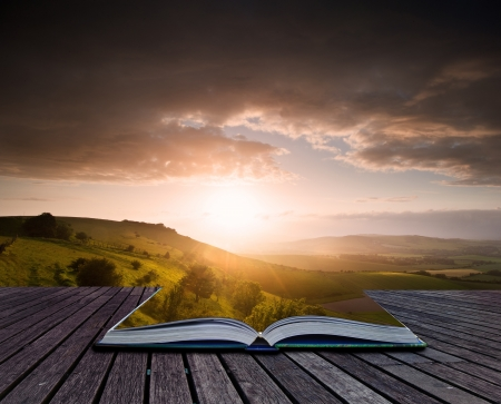 Creative composite image of Summer landscape in pages of magic book photo