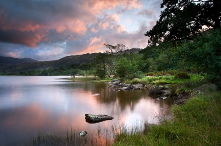 Stunning colorful sunrise over Llyn Gwynant in Snowdonia National Park with Carneddau mountain range in distance Stock Photo - 15533525