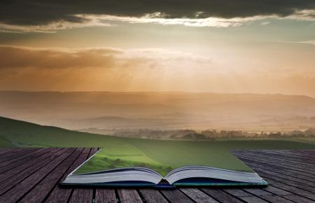Creatieve samengesteld beeld van de zomer landschap in pagina's van magische boek