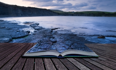 composite image: Creative composite image of seascape in pages of magic book Stock Photo