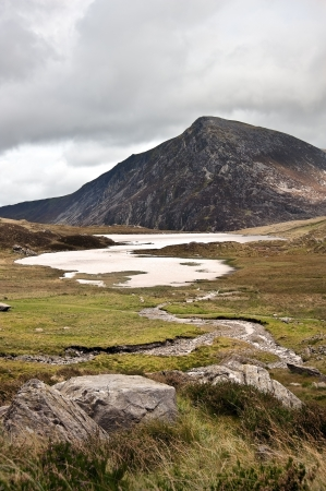 View over Llynn Idwal in Glyderau mountain range in Snowdonia National Park towards Pen-yr-Ole-Wen in distance Stock Photo - 15887466