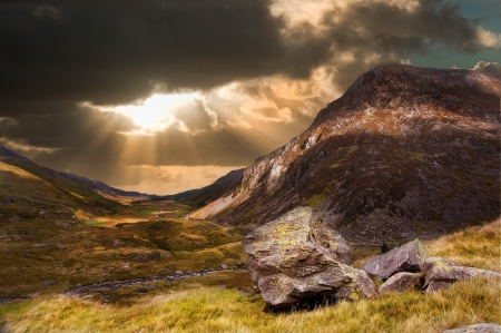 Dramatic sunset with beautiful sky over mountain range giving a strong moody landscape photo