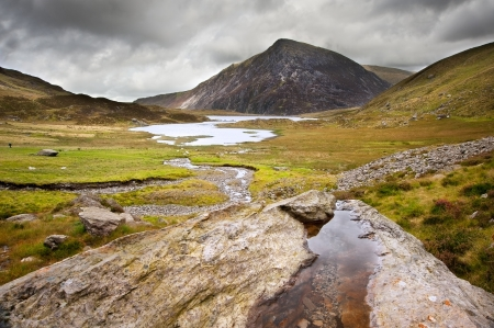 View over Llynn Idwal in Glyderau mountain range in Snowdonia National Park towards Pen-yr-Ole-Wen in distance