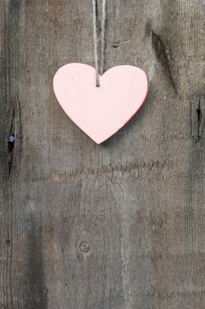 Valentine heart on slate grunge background photo