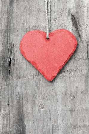 Valentine heart on grunge wooden background photo